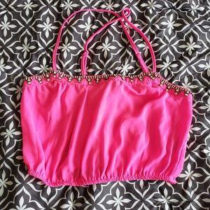 Hot pink crop top with jewels.